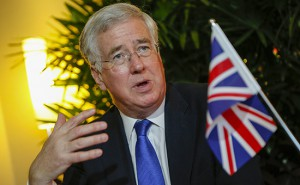 British Secretary of State for Defense Michael Fallon speaks to the media after signing a Joint Statement on Defense Cooperation with New Zealand, on the sidelines of the 14th International Institute for Strategic Studies Shangri-la Dialogue, or IISS, Asia Security Summit, Friday, May 29, 2015, in Singapore. The summit will be held from May 29-31. (AP Photo/Wong Maye-E)